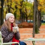 Girl in outdoor Parisian cafe — Stock Photo #48514925
