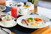 Fried eggs, fruit salad and fresh watermelon juice — Stock Photo