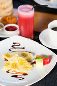 Balinese banana pancake and watermelon juice — Stock Photo