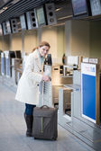 Woman at check in in the airport — Stock Photo