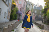 Happy young girl on a street of Montmartre — Stock Photo