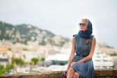 Elegant young woman in the Old town of Cannes — Stock Photo