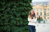 Girl on a Parisian street decorated for Christmas — Stock Photo