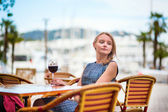 Young French woman drinking red wine — Stock Photo
