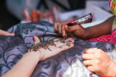 Henna decoration being applied to hand — Stock Photo