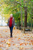Girl walking in a park — Stock Photo
