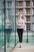 Young business woman in modern glass interior — Stock Photo