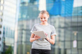 Young business woman using tablet — Stock Photo