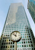 Clock and skyscrapers. — Stock Photo