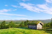 Small house on a hill. — Stock Photo