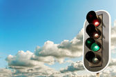 Big clouds and traffic light. — Stock Photo