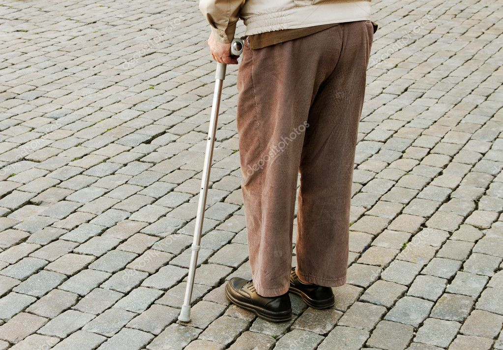 Old man with crutch on a street. — Stock Photo #19090133