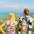 Two tourists on hill. — Stock Photo