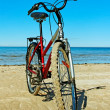 Stock Photo: Bike on the beach.