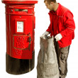 Red mail-box and worker. — Stock Photo