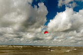 Kiteboarder above sea. — Stock Photo