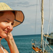 Woman at the sailboat. — Stock Photo
