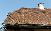 Damage tile roof. — Stock Photo