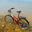 Stock Photo: Bicycle on the beach.