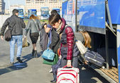 Passengers on bus station. — Stock Photo