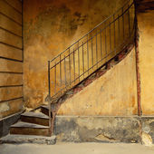 Stairs of old yellow house — Stock Photo