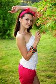 Beautiful girl in pin-up style near the tree — Stock Photo