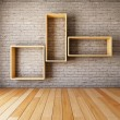 Brick wall with empty shelves — Stock Photo