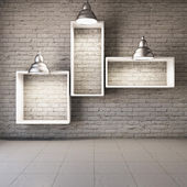 Brick wall with empty shelves — 图库照片