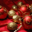Red christmas balls and golden walnuts — Stok fotoğraf #1135213