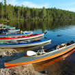 Colorful canoes on lake,Polar Karelia, Russia — Stock Photo