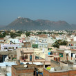 Old roofs of Udaipur with Monsoon Palace,India — Stock Photo