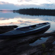 Canoe at stone bank of Engozero lake,Polar Karelia, Russia — Stock Photo