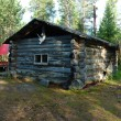 Wooden fisherman's house in pine forest ,Karelia,Russia — Stock Photo