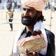 Snake charmer perform at annual camel fair ,Rajasthan,India — Stock Photo
