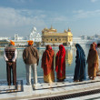 Stock Photo: People are praying at sacred lake of famous Golden Temple - main holy place of sikh religion,India