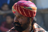 Old rajput shows his moustache at moustache competition at Pushkar cattle fair,Rajasthan,India — Stock Photo