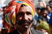 Old rajput shows his moustache at moustache competition at Pushkar camel fair,Rajasthan,India — Stock Photo