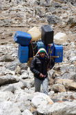 Sherpa porter carry heavy load in the Himalaya at Everest Base Camp trek,Nepal,Himalayas — Stock Photo