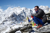 Climber sitting at the foot of Kala Patthar mountain near Gorakshep village, Everest region, Nepal. Kala Patthar mountain has excellent view to Chomolungma summit — Stock Photo