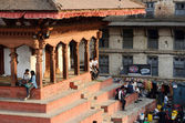 People resting at Durbar Square in Kathmandu, Nepal. Old Durbar Square is one of the most popular tourist attractions in Asia, receiving millions of visitors annually — Stock Photo