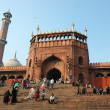 Stock Photo: Worshippers are walking on courtyard of Jama Masjid Mosque - main mosque of Old Delhi,India