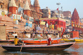 Hindu people are making ritual bathing at ghats in holy Ganges River,Varanasi,India — Stock Photo