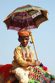 Young cameleer preparing to take part at camel decoration competition at cattle fair in Pushkar ,India — Stock Photo