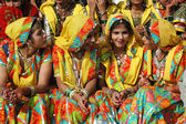 Beautiful indian women in traditional rajasthani clothes preparing to dance at annual camel fair holiday in Pushkar,India — Stock Photo