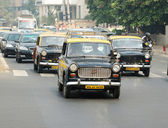 Mumbai traffic with several classical ambassador cabs,it is unique style of taxi,India — Stock Photo