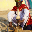 Nomad snake charmer playing at camel mela,Pushkar,India — Stock Photo
