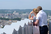 Tourist couple looking at modern part of Lviv city,Ukraine — Stock Photo