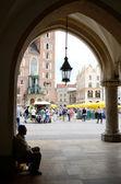 Old man sitting inside Renaissance Sukiennice,Krakow,Poland — 图库照片