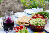 Summer still life with tomatos,wine,bread,salad and spring onion — Foto de Stock