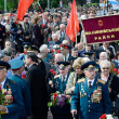 :Veterans of Second World War coming to lay flowers at Uknown Seaman Monument in a commemoration of Soviet warriors who fought against Nazi invasion during Second World War,Odessa,Ukraine — Stock Photo #46152791